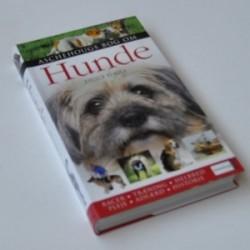 Hunde - Aschehougs bog om hunde. Racer, træning, helbred, pleje, adfærd og historie
